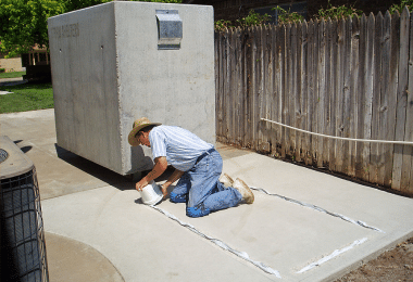Placing epoxy to adhere the storm shelter