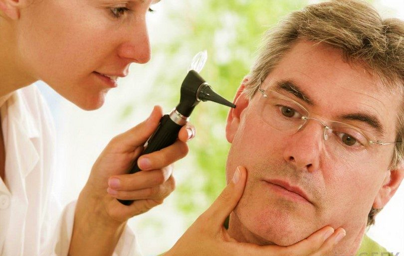 physician checking ear