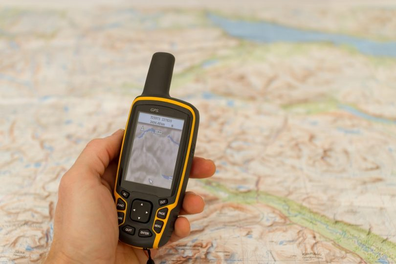 Hand held outdoor GPS and a map