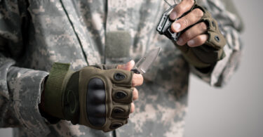 military neck knife on survival-mastery