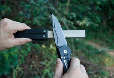 Man with pocket knife sharpener