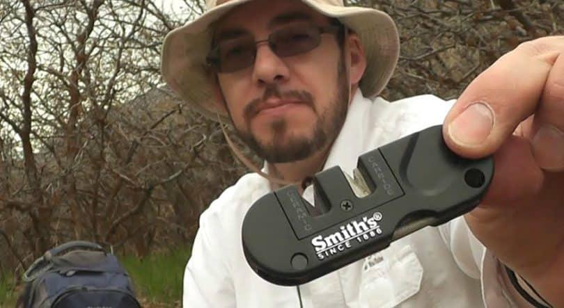 Man holding pocket-sharpener