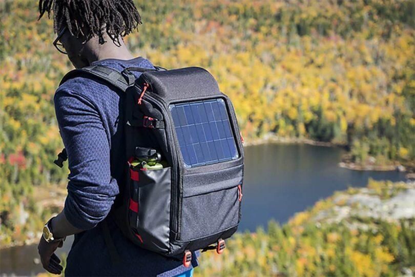 Man is Wearing Solar Backpack