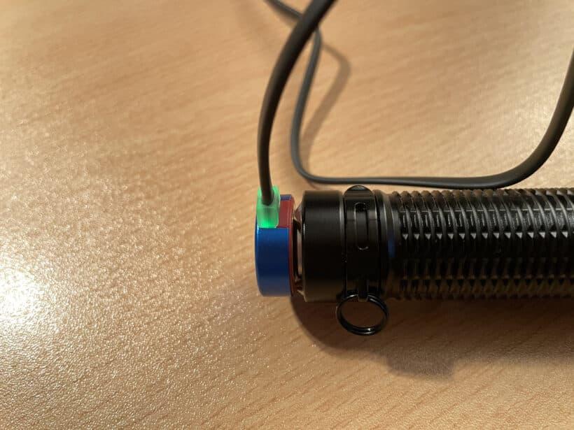Olight Warrior Mini 2 LED Light on charger