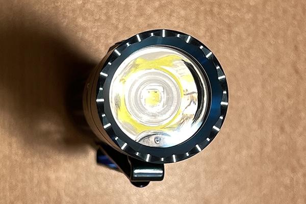 Closeup of flashlight optic