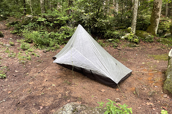 Tent set up at Mill Creek campsite by stream