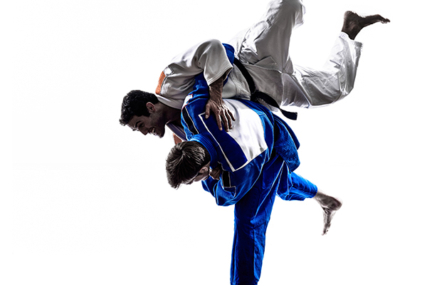 Two fighters using Judo